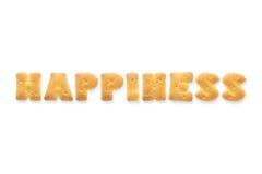 La galleta de la galleta del alfabeto de la FELICIDAD de la palabra de la letra Imágenes de archivo libres de regalías