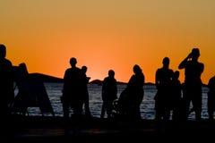 La gente al tramonto Immagini Stock Libere da Diritti