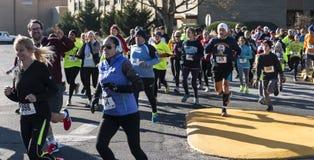La gente che corre al trotto di tacchino locale di Al corre Fotografie Stock