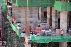 La gente che lavora al cantiere a Bangkok Tailandia Immagine Stock