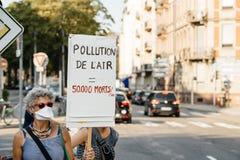 La gente che protesta contro l'inquinamento atmosferico Fotografie Stock Libere da Diritti