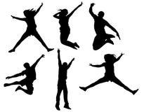 La gente che salta nel nero Fotografia Stock