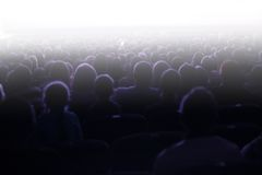 La gente che si siede in un pubblico Immagine Stock Libera da Diritti