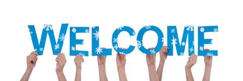 La gente che tiene benvenuto del blu Immagine Stock