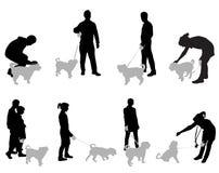 La gente con i cani Immagini Stock