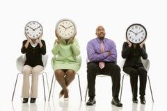 La gente con i fronti di orologio Immagine Stock