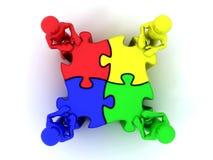 La gente con il puzzle Fotografie Stock