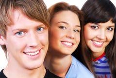 La gente con il sorriso sul fronte Fotografia Stock