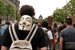 La gente con la maschera anonima durante la dimostrazione contro Monsanto e il transatlantique t Immagine Stock Libera da Diritti