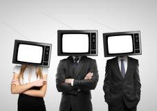 Gente con la cabeza de la TV Imágenes de archivo libres de regalías