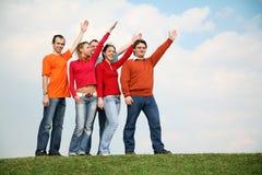 La gente con le mani sollevate Fotografie Stock