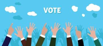 La gente da a voto con aumento su fondo del azul de la mano Imágenes de archivo libres de regalías