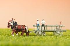 La gente del giocattolo con i cavalli Fotografie Stock
