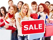 La gente del gruppo con la vendita del bordo. Immagini Stock