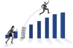 La gente di affari che salta sopra gli istogrammi Fotografia Stock