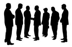La gente di affari raggruppa ad una riunione che stringe le mani Fotografia Stock