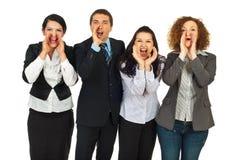 La gente di affari raggruppa gridare fotografia stock