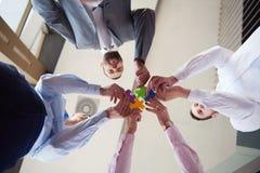 La gente di affari raggruppa il puzzle di montaggio Fotografia Stock Libera da Diritti