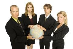 La gente di affari tiene un globo Fotografia Stock
