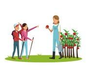 La gente e fare il giardinaggio Fotografia Stock