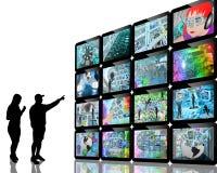 La gente e schermi Fotografia Stock