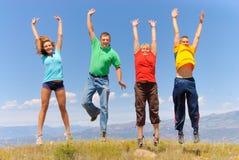 La gente feliz salta Imágenes de archivo libres de regalías