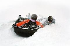 La gente ha divertimento in inverno Fotografia Stock
