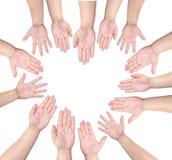 La gente levanta su mano para ofrecerse voluntariamente en shap del corazón Imágenes de archivo libres de regalías