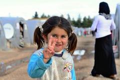 La gente nel campo profughi Fotografie Stock