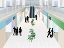 La gente nel centro commerciale con due pavimenti Fotografia Stock