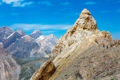 La gente nell'avventura della montagna Fotografia Stock