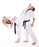 La gente nella lotta del kimono su bianco Fotografia Stock