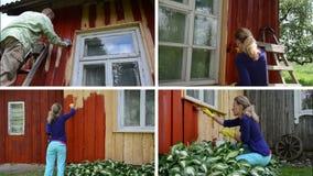 La gente renueva la casa de campo Pared de la pintura en rojo Acorta el collage almacen de metraje de vídeo