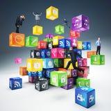 La gente sui cubi dell'icona Fotografie Stock Libere da Diritti