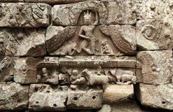 La gente sulla parete del wat di Angkor Immagine Stock
