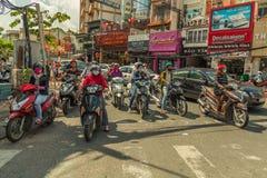 La gente sulla via di paese asiatico - il Vietnam e la Cambogia Fotografie Stock Libere da Diritti