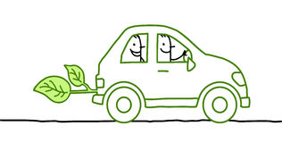 La gente in un'automobile verde Immagini Stock
