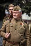 La gente in uniforme militare in onore della festa di Victory Day Fotografia Stock Libera da Diritti