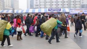 La gente va a casa durante Año Nuevo chino Fotografía de archivo libre de regalías
