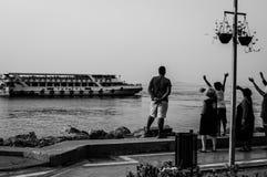 La gente Wave arrivederci alla loro famiglia ed amici Fotografia Stock Libera da Diritti