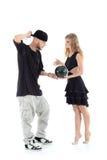 La ginnasta dà la palla al rapper Immagini Stock Libere da Diritti