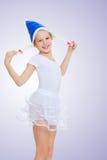 La ginnasta della ragazza nel cappuccio Santa Claus Immagine Stock Libera da Diritti