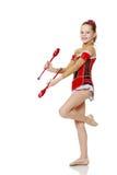 La ginnasta si esercita con un macis Fotografia Stock