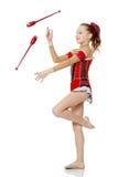 La ginnasta si esercita con un macis Fotografie Stock