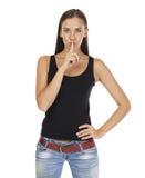 La giovane bella donna ha messo l'indice alle labbra come segno di sile Immagini Stock Libere da Diritti