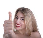 La giovane bella donna mostra come isolato su fondo bianco. Immagine Stock Libera da Diritti