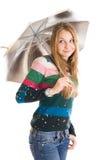 La giovane bella ragazza con un ombrello isolato Fotografia Stock Libera da Diritti