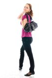 La giovane bella ragazza con una borsa isolata Fotografia Stock