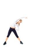 La giovane bella ragazza di sport fa l'allungamento di esercizio di forma fisica Immagini Stock Libere da Diritti