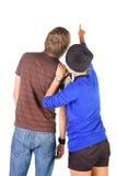 La giovane coppia esamina il bianco. La retrovisione. Immagini Stock